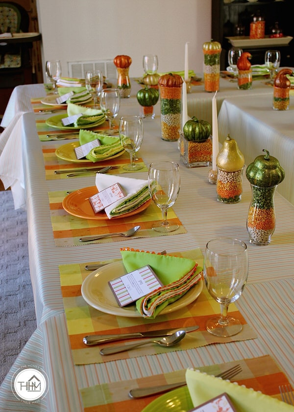 Thanksgiving tablescape done in yellows, greens, and oranges