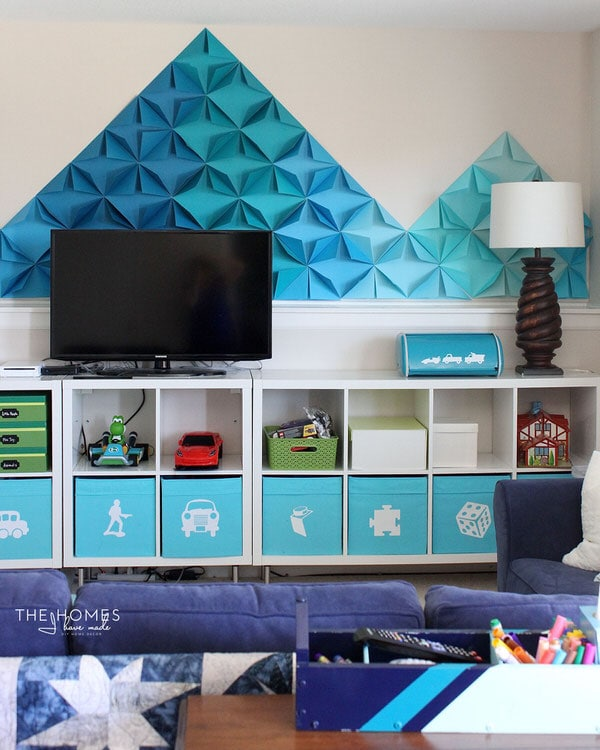 Check out how this military family transformed their rental basement into a fun and functional playroom complete with smart toy storage and whimsical DIY decorations!