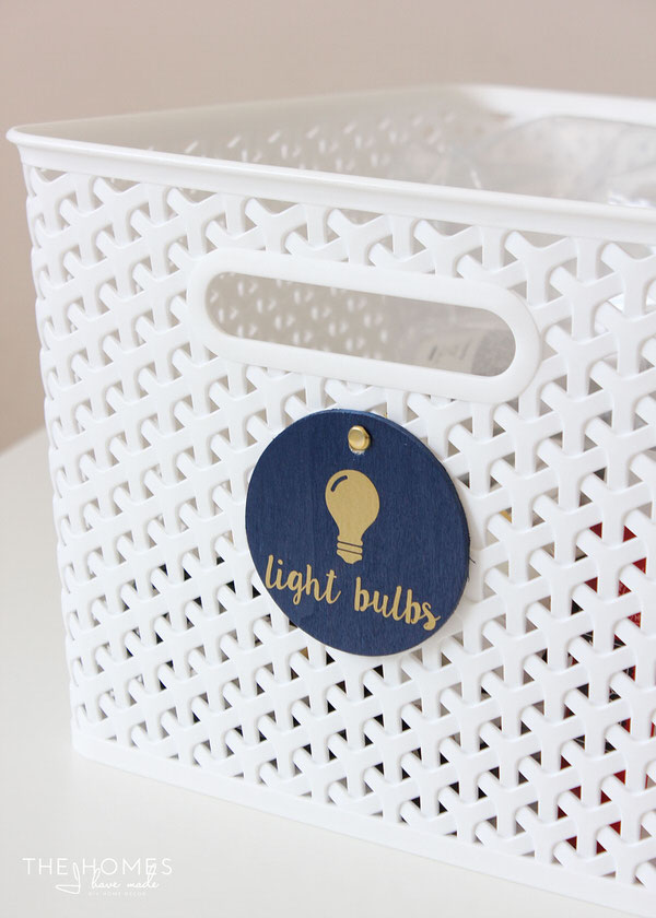 Use chipboard rounds and vinyl letters to labels linen closet baskets!