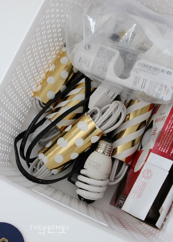 Corral un-tidy cords by wrapping them in cardboard tubes!