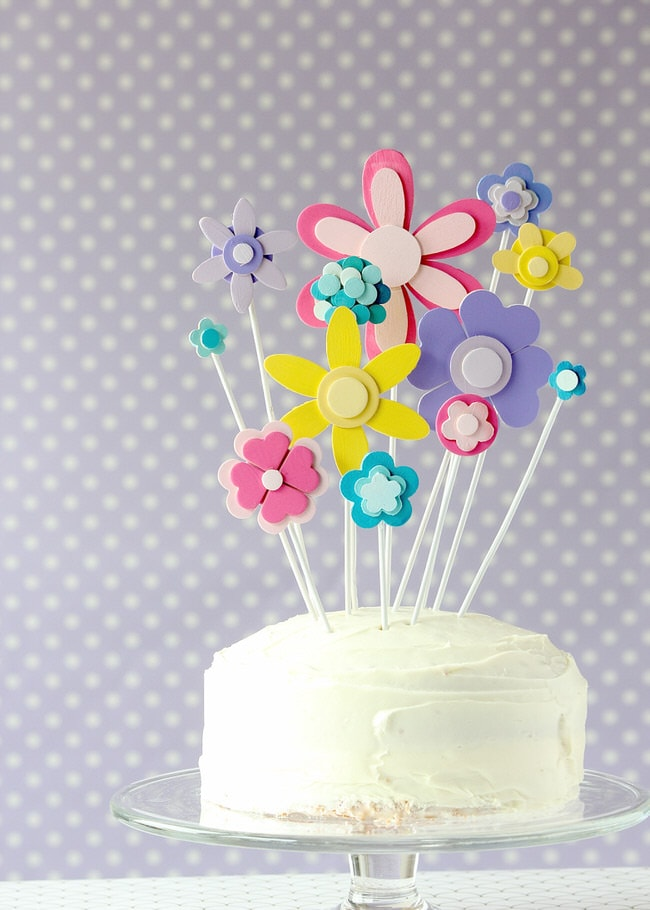 Make this charming and oh-so-easy cake topper for your next Spring soiree by painting and glueing basic wooden shapes into pretty flowers!
