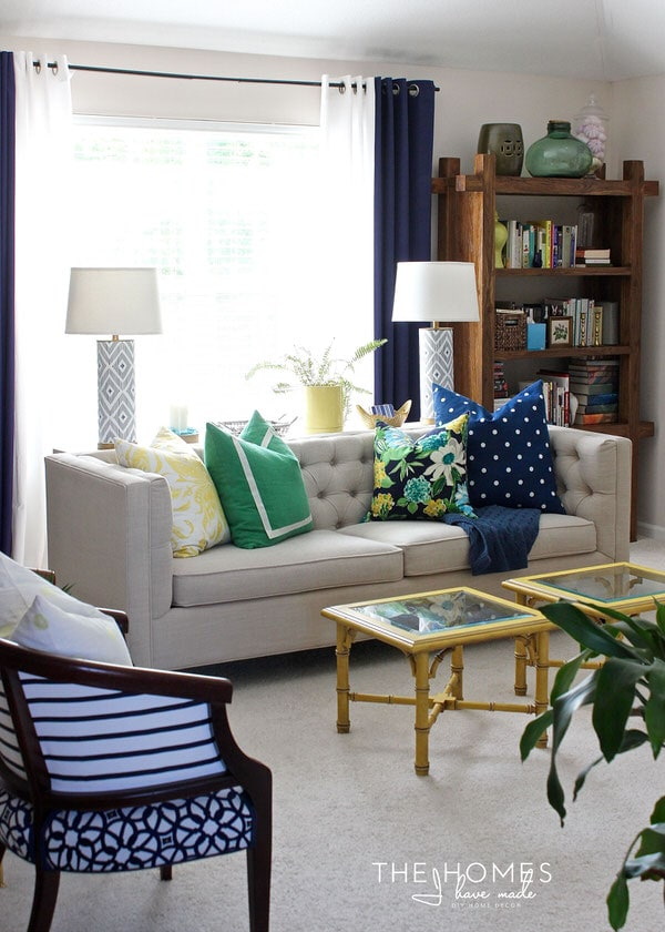 preppy and bright family room done in navy green and yellow