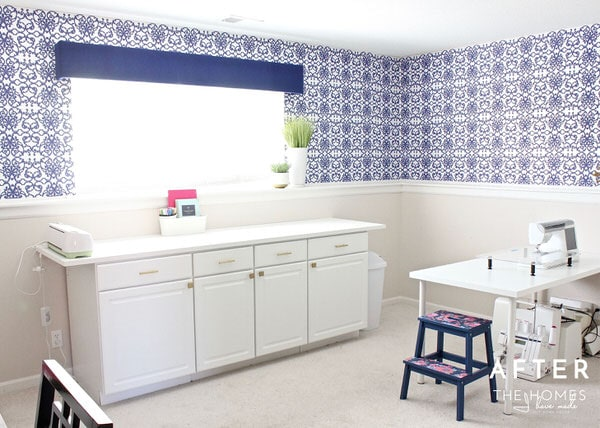 Check out this modern home office and craft space full of smart storage solutions, a hardworking layout, and vibrant design details!