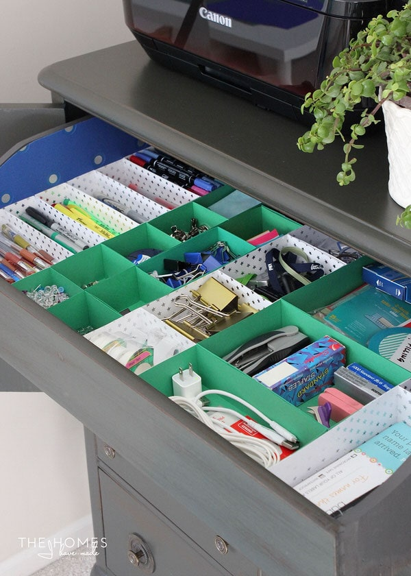 Using an armoire is a clever and effective way to store office supplies!