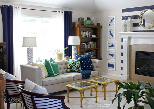Neutral furniture and colorful accessories transform this boring rental living room into a preppy and playful family space!