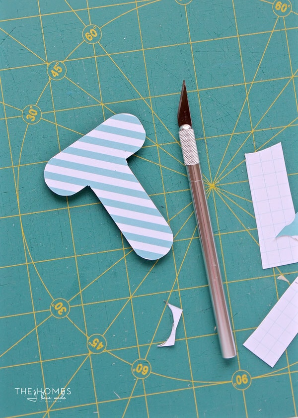 Ever see all those fun wood shapes and letters at the craft store and wonder what you could do with them? Learn how to easy it is to transform them into personalized key chains!