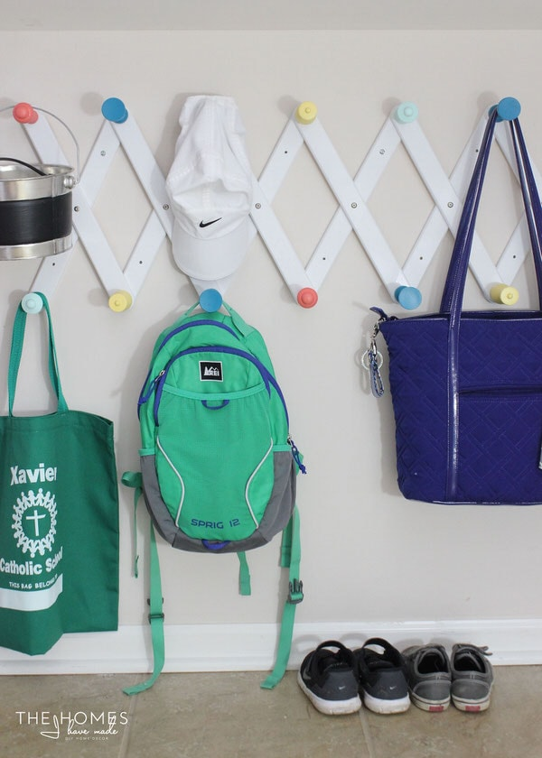 A bulletin board, picture ledge, and set of hooks come together to make the perfect drop zone for any kid space!
