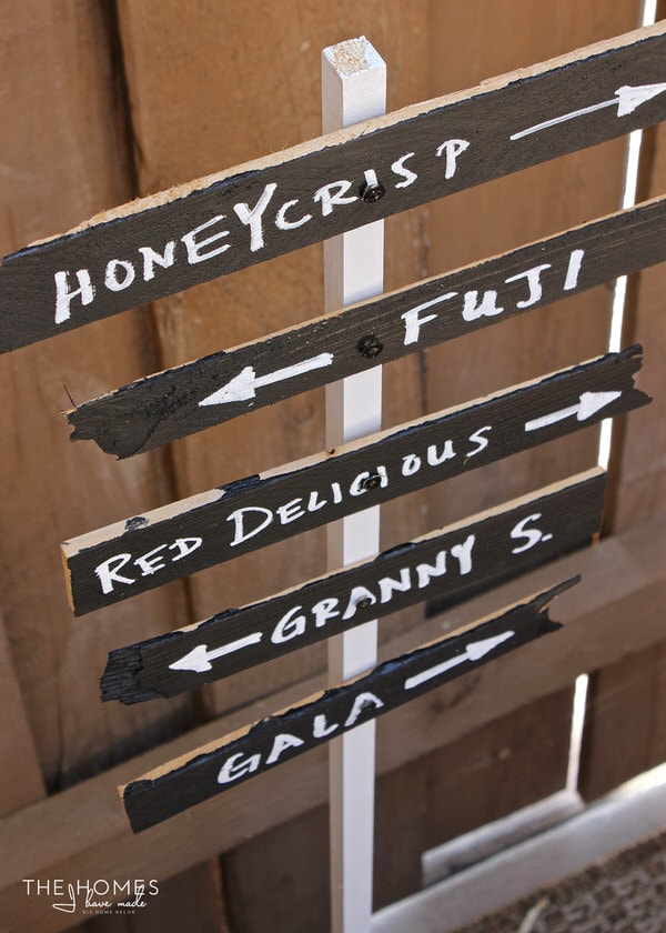 Decorate your Fall Porch display with this oh-so-easy Apple Orchard sign!