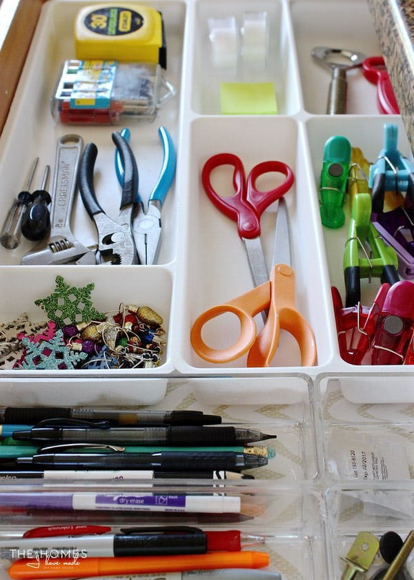 Organized junk drawer in the kitchen with IKEA drawer dividers