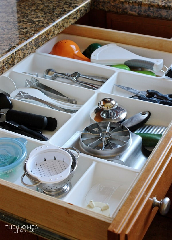White drawer dividers organize this kitchen drawer