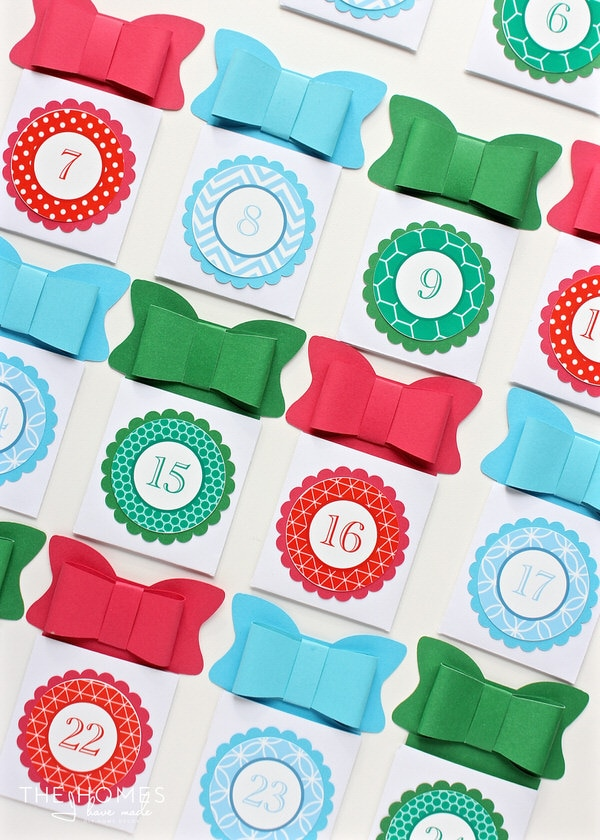 Count down the days until Christmas with this easy and kid-friendly DIY Advent Calendar. Each day, reveal a letter to a secret hidden holiday message!