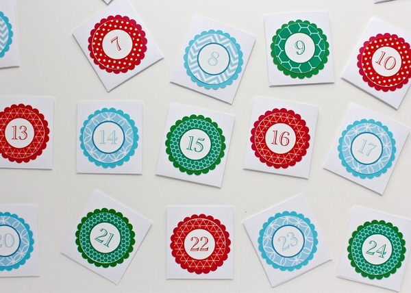 Use the Cricut Explore to create a fun and kid-friendly DIY Advent Calendar. Each day, pull down an envelop to reveal a letter in a hidden holiday message!