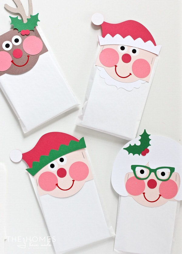 Top of a bag of treats for everyone on your list with these adorable Christmas Character Treat Bag Toppers - made with paper and the Cricut Explore!