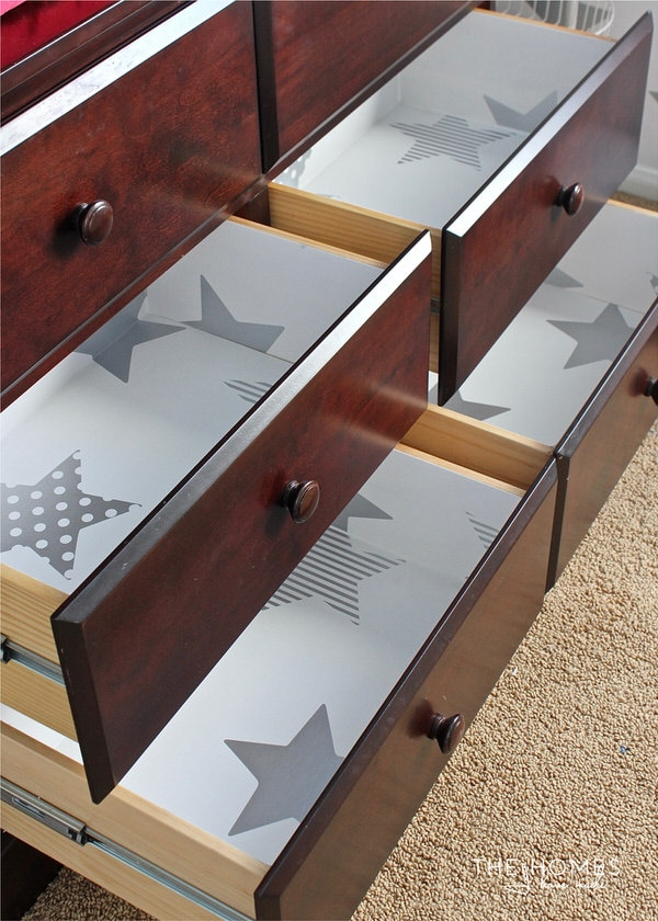 Learn how to line drawers with wallpaper for a great pop of pattern with professional-looking results!