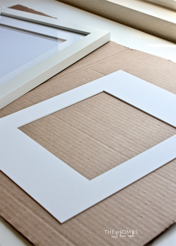 white frame mat with a square cut out of the middle.