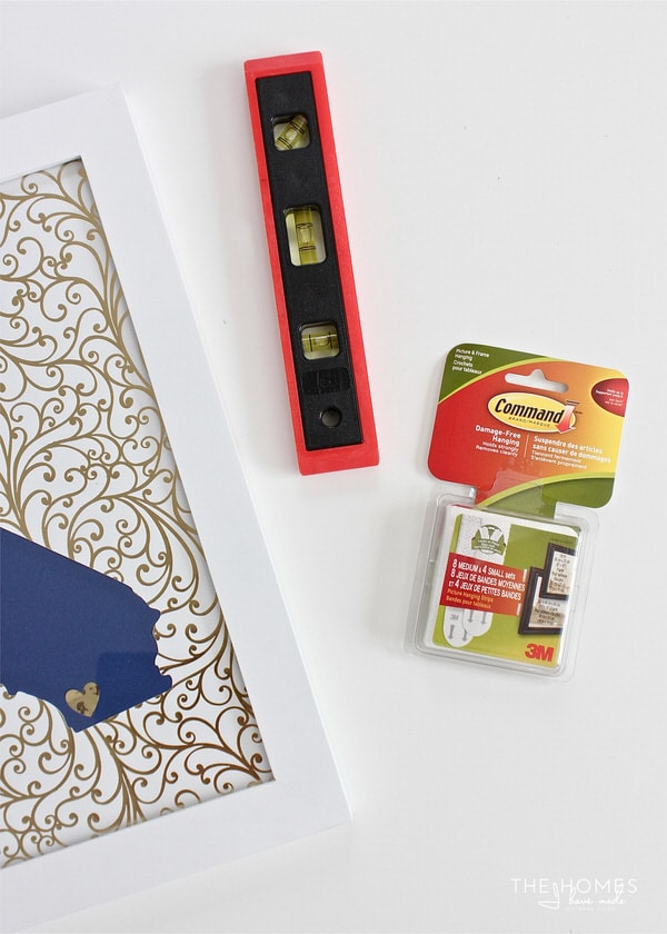 Learn how to hang a gallery wall with Command Strips in order to achieve perfectly placed frames without nails in your wall!