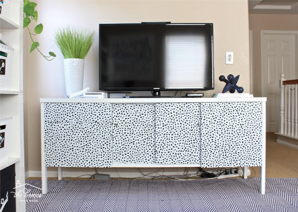 Want to give your furniture a new look without the permanence of paint? Learn how to update furniture with peel-and-stick wallpaper!
