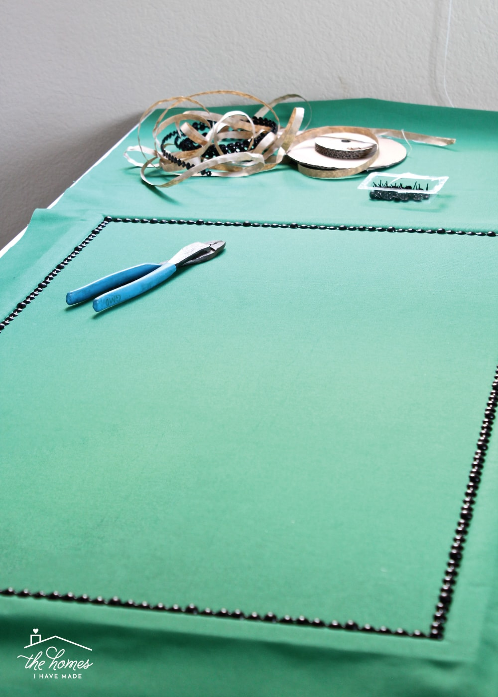 Give a basic bulletin board an easy, inexpensive and stylish upgrade with fabric and nailhead trim!
