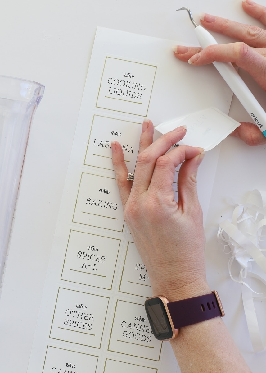 Peeling off a label made by a cricut joy machine