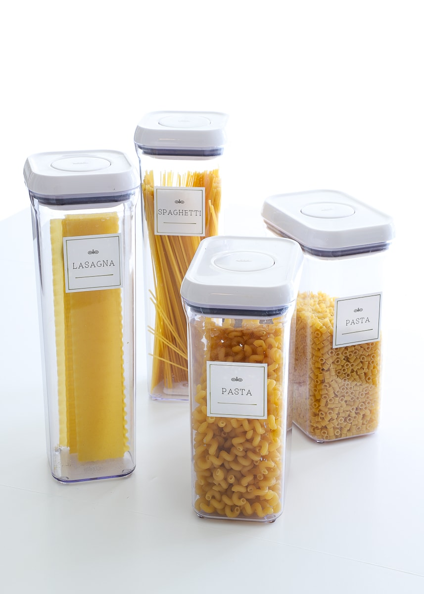 variety of clear plastic pasta containers with label stickers