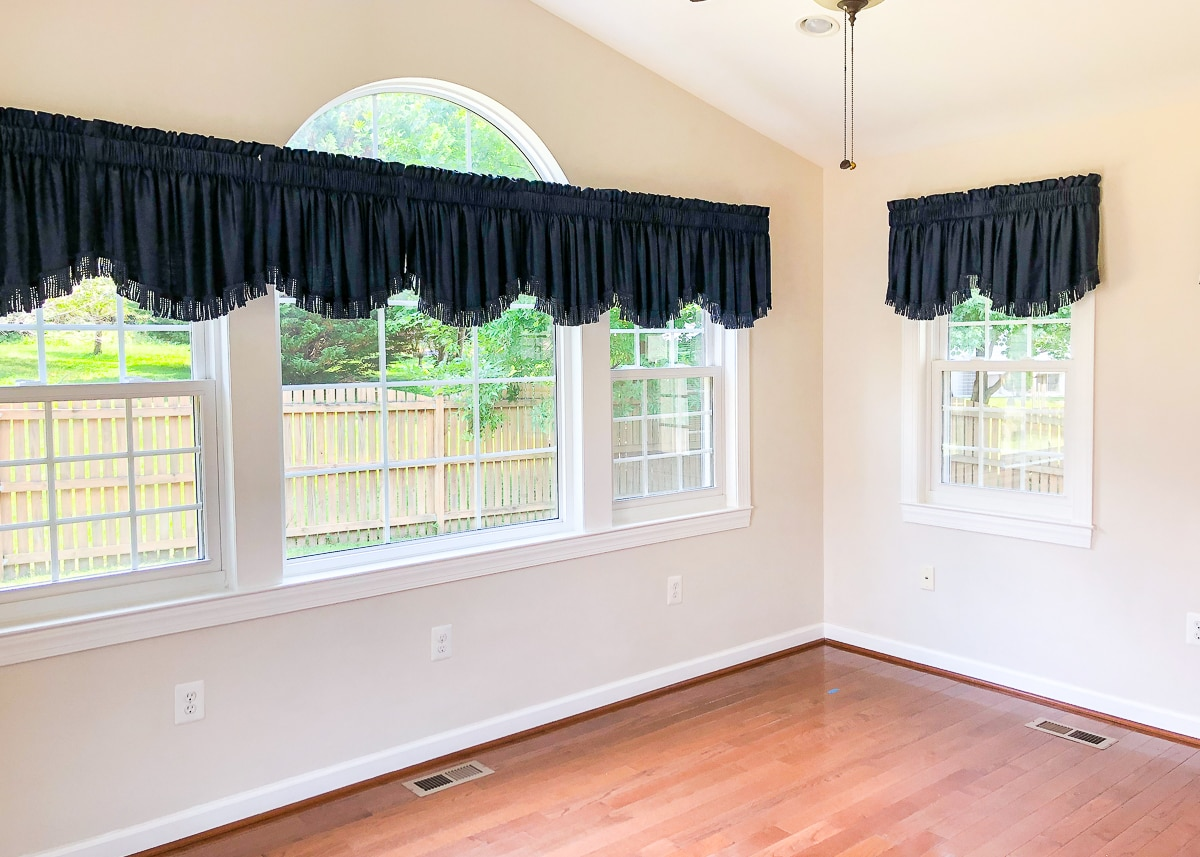 large arched window with blue valence curtains