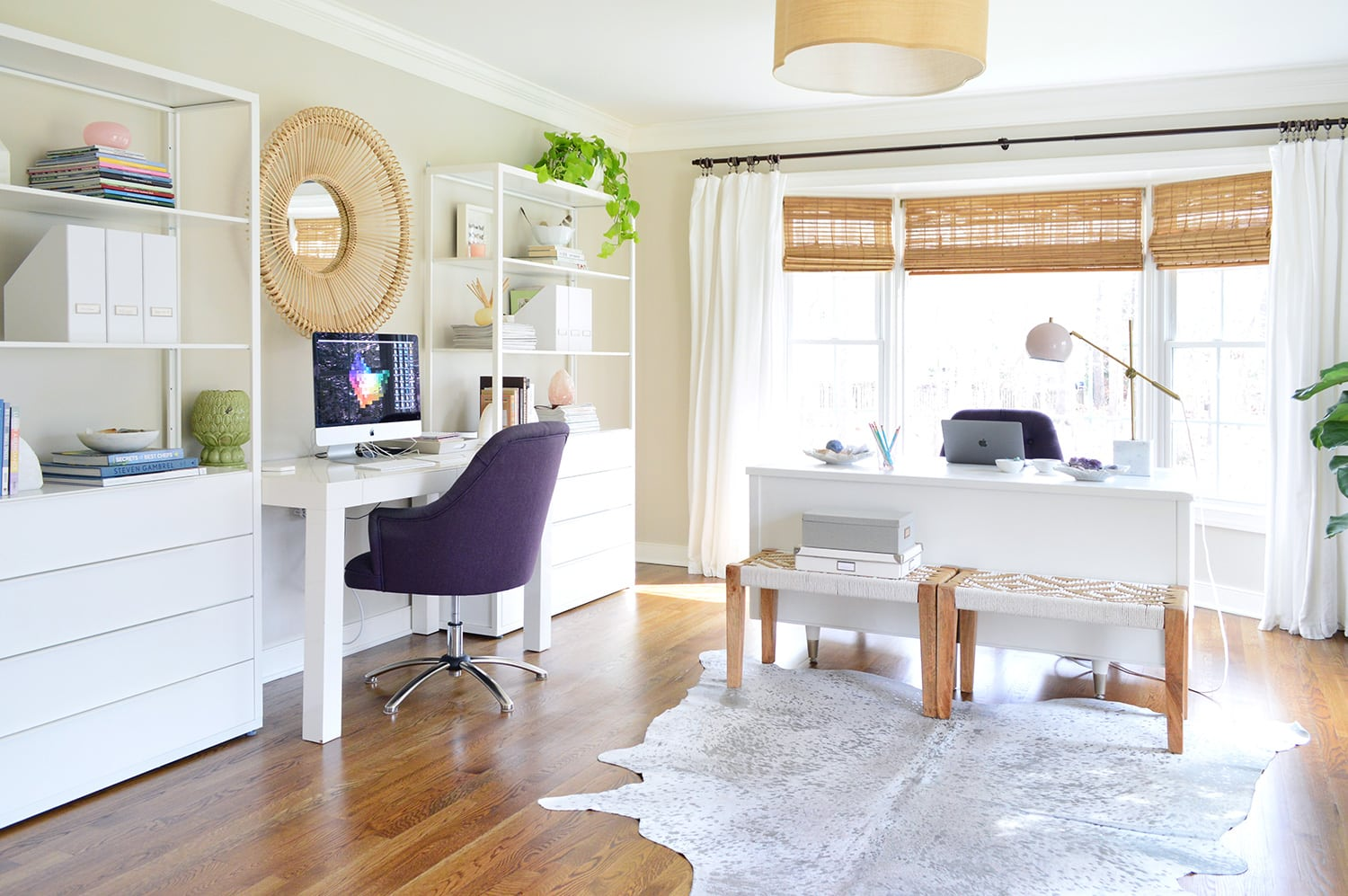 home office with giant bay window and window treatments
