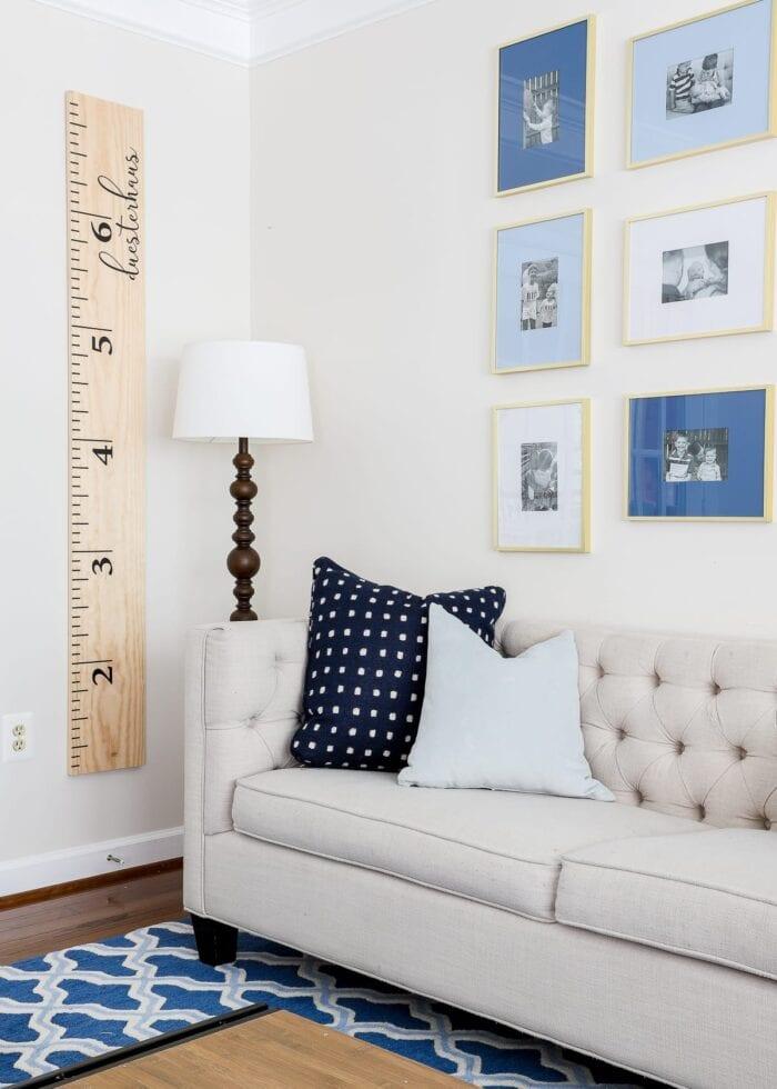 DIY Wall Ruler hung in a blue playroom