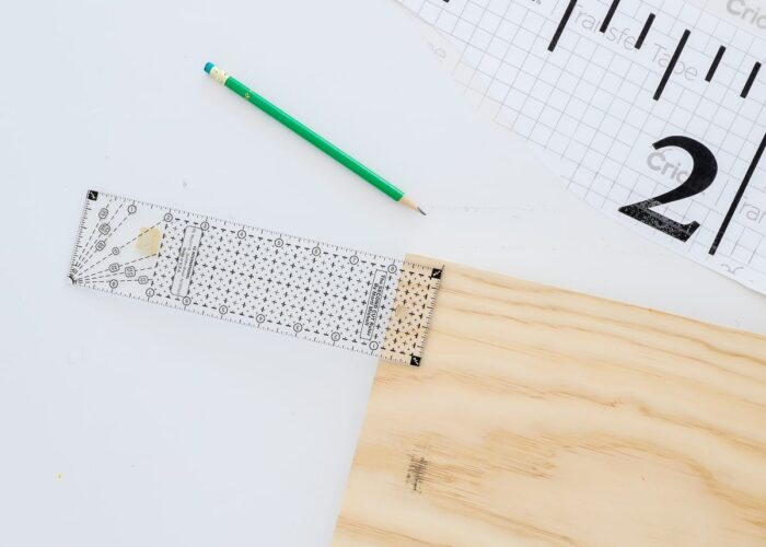 """Measure 1"""" in on the wood board"""