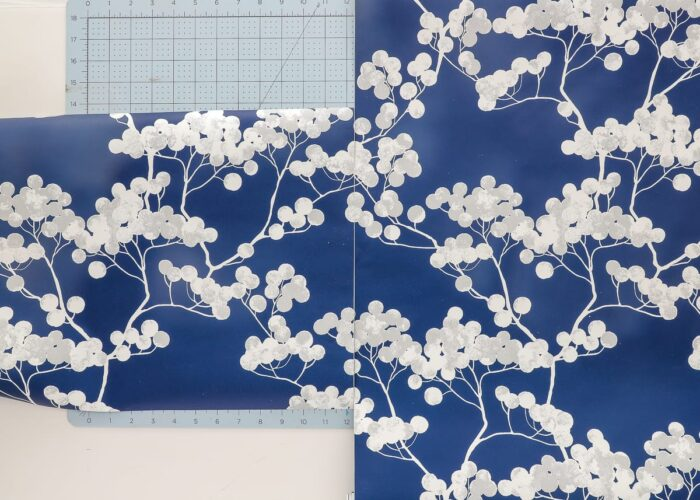 use peel and stick wallpaper to cover the foam board window valance