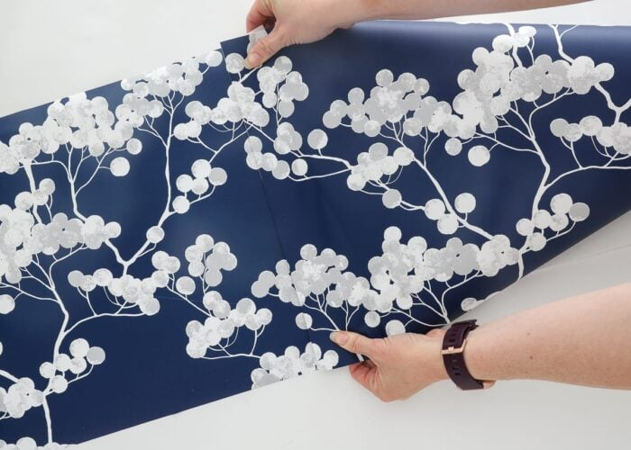 this simple foam window valance is wrapped in pretty blue wallpaper