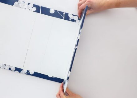 this simple blue window valance is made with foam board and wallpaper