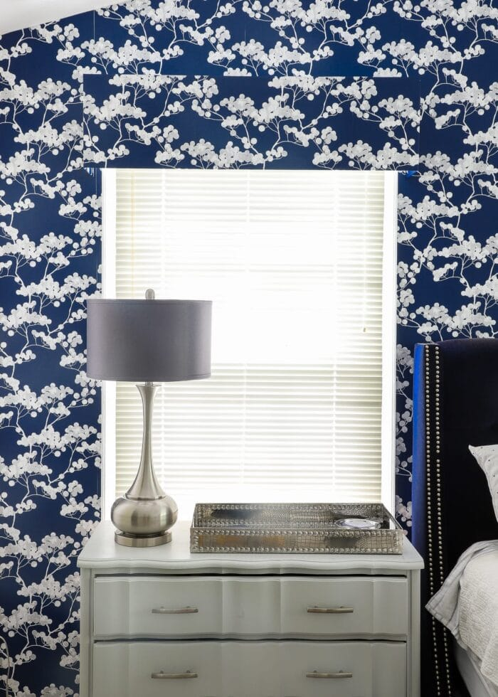 this simple blue window valence is made with foam board and wallpaper