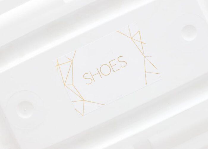Gold foil label on a shoebox