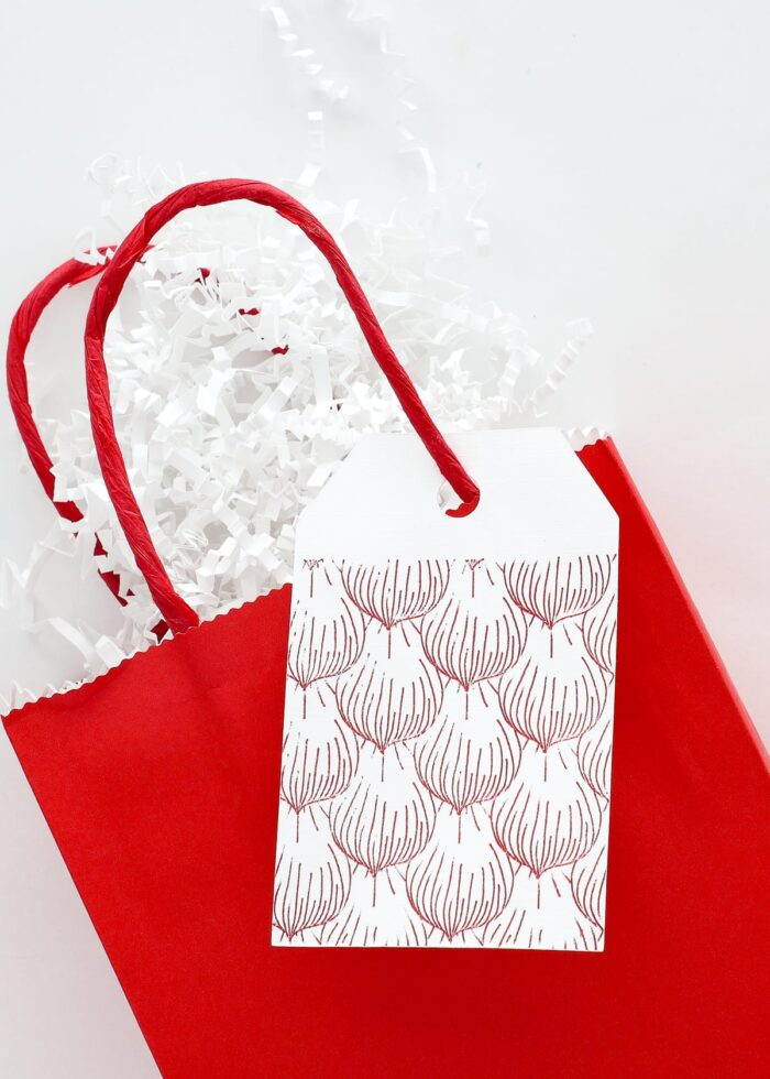 Red foiled gift tag on red gift bag