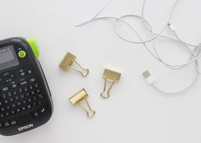 cold paperclips with white cords and label maker