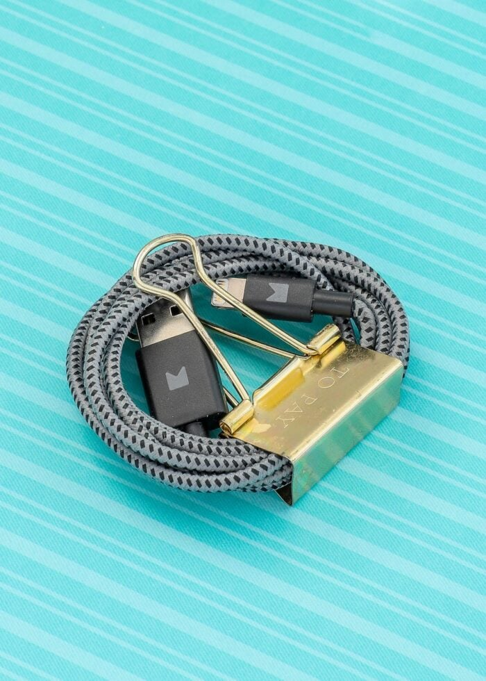 Black cords clipped with a gold paperclip