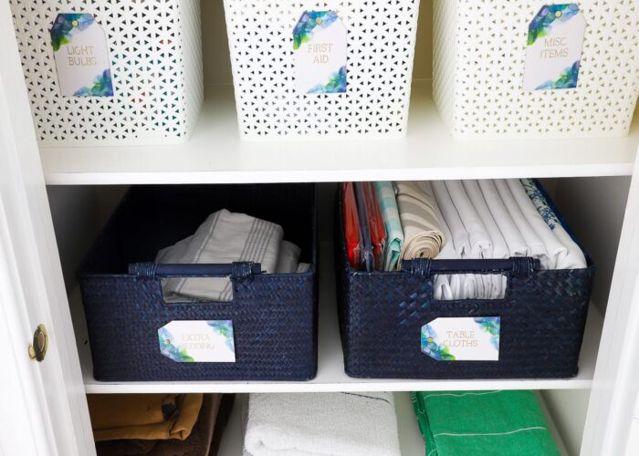 Sturdy baskets and gorgeous labels keep this linen closet perfectly organized.