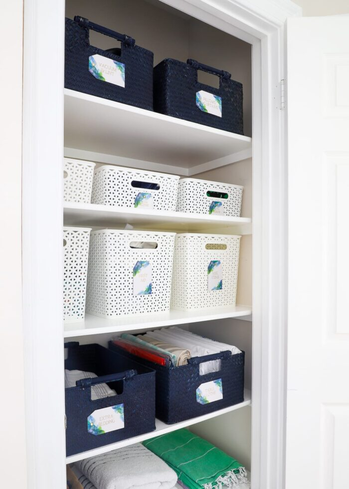 This hallway linen closet is organized to perfection.