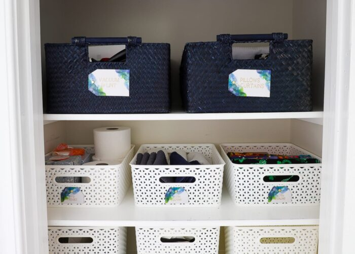 Sturdy baskets and gorgeous labels keep this linen closet organized.