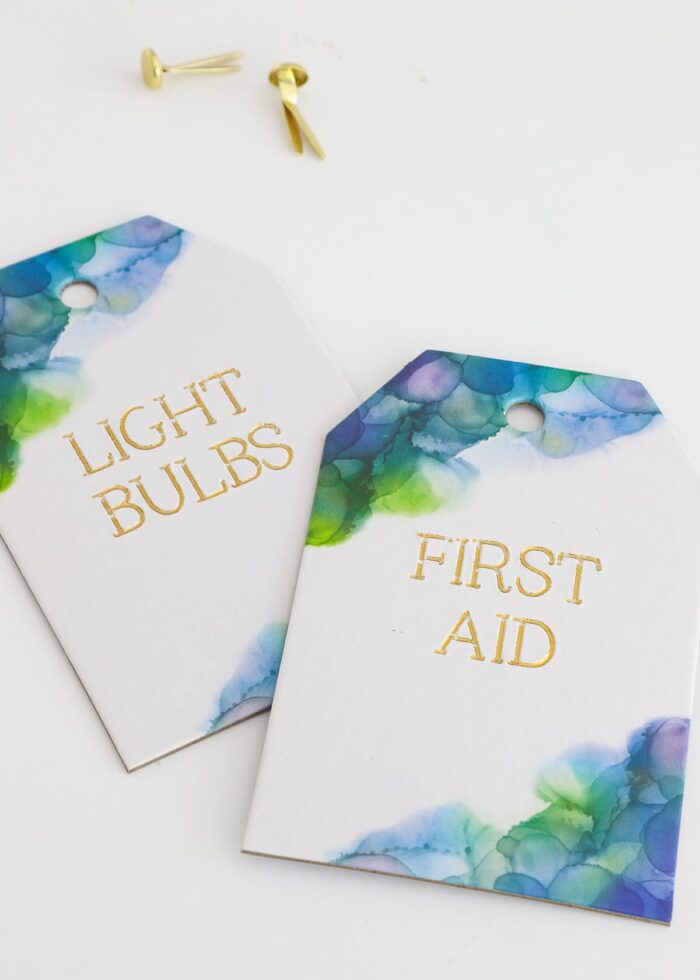 Watercolor tags with gold foiled lettering.