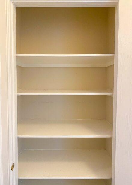Empty hallway linen closet.