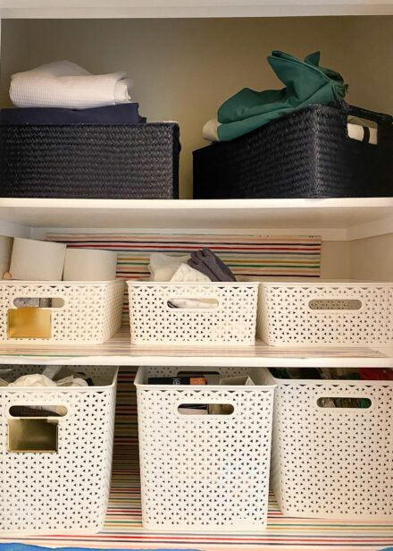 This linen closet is untidy and in need of a little extra organization.