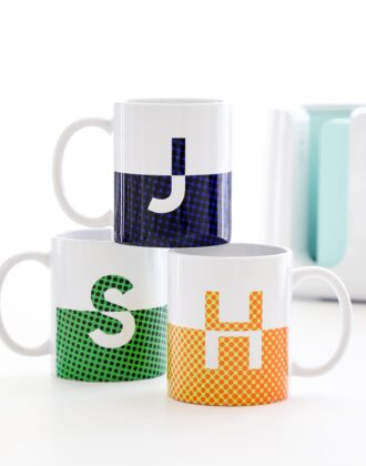Split monogram mugs in blue, green and orange