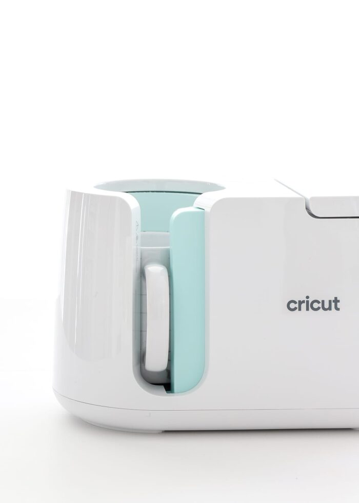 Split Monogram Mug inserted into Cricut Mug Press