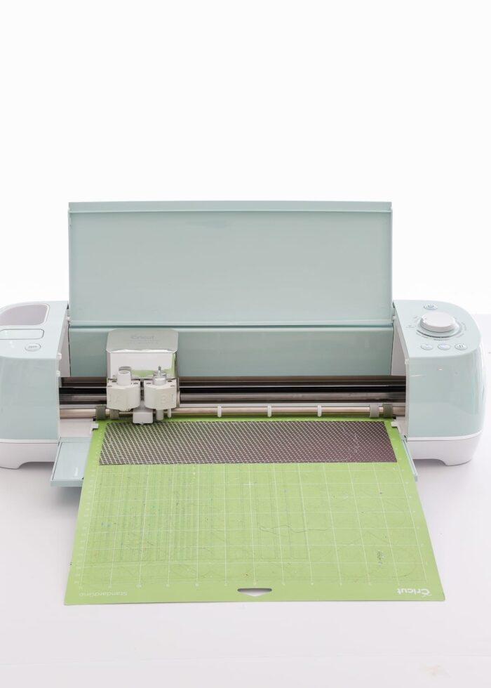 Cricut Explore Air 2 cutting a sheet of Infusible Ink
