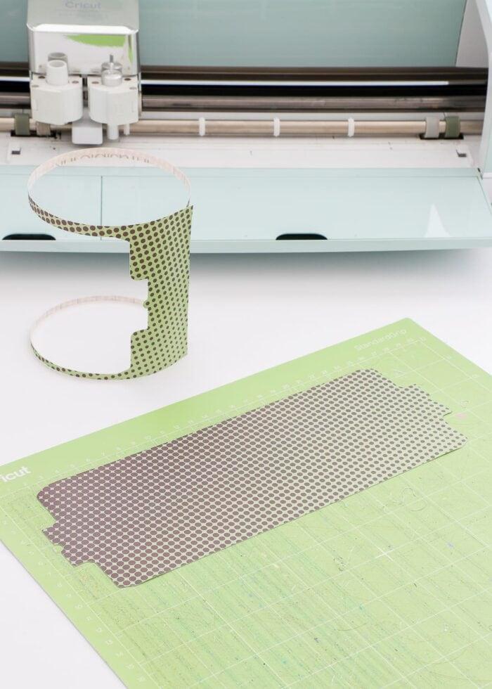 Split monogram mug design cut out of Infusible Ink Transfer Sheet on a Cricut Mat