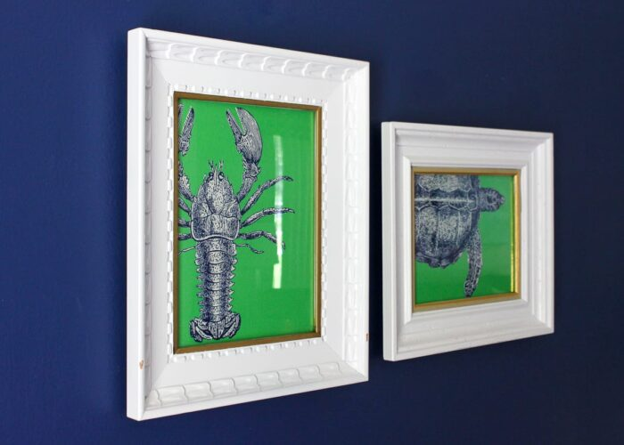 White frames with blue and green sea life pop art on a blue wall