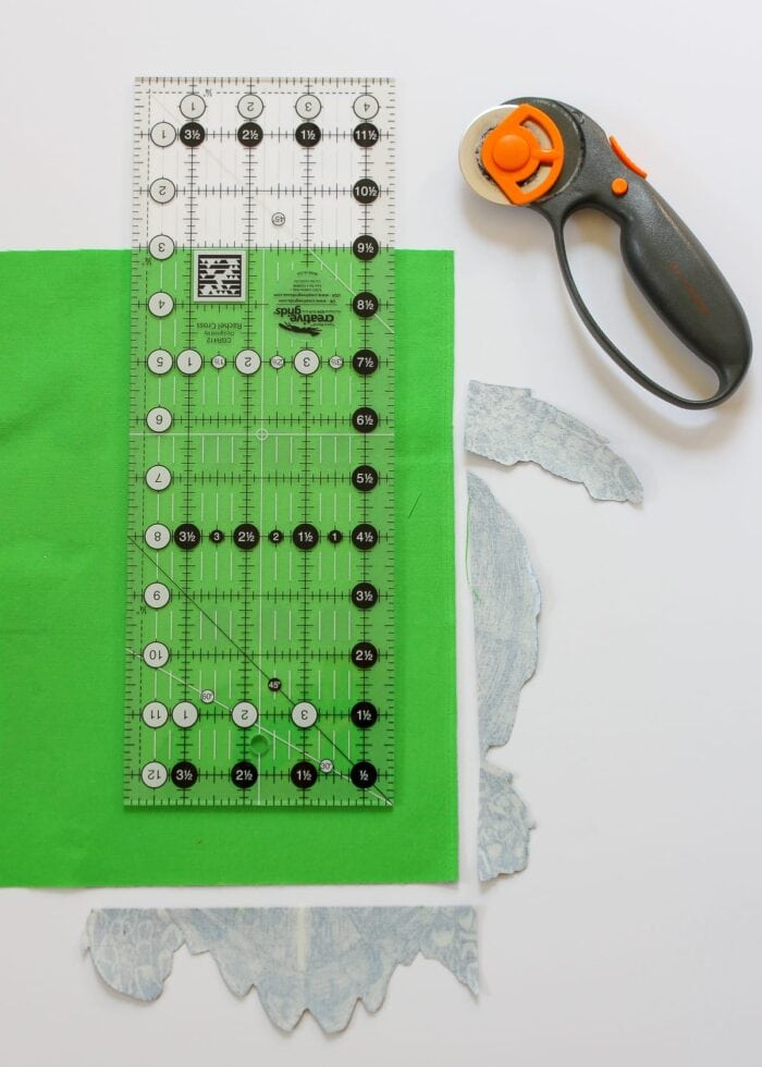 Green fabric with ruler and rotary cutter