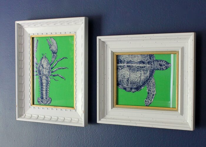 White frames with DIY Sea Life Pop Art on a blue wall