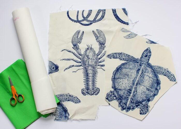 Sea creature fabric with green fabric, Heat'N'Bond and scissors